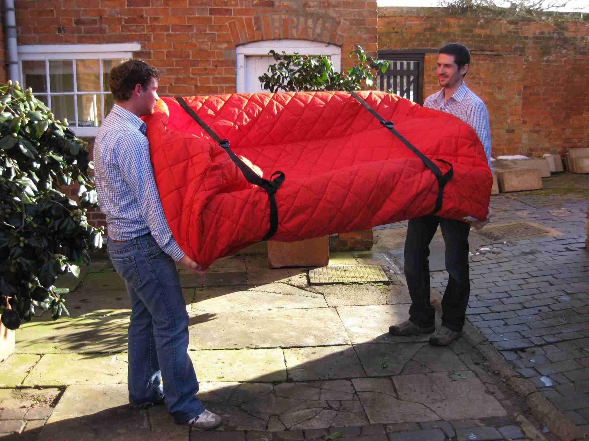 Carrying sofa with a furniture protection cover
