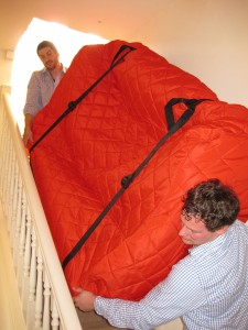 C-W-carrying-sofa-down-stairs-small